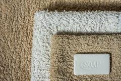 Fondo dell'asciugamano e del sapone Immagine Stock