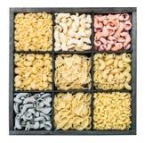 Fondo dell'assortimento della pasta su fondo bianco Fotografia Stock Libera da Diritti