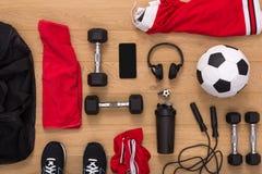 Fondo dell'attrezzatura di allenamento, di calcio e di sport Fotografie Stock