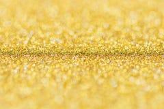 Fondo dell'oro, spazio in bianco astratto del bokeh di scintillio di Natale per il desi fotografie stock