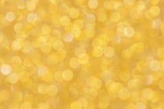 Fondo dell'oro, spazio in bianco astratto del bokeh di scintillio di Natale per il desi fotografia stock libera da diritti