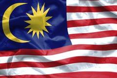Fondo della bandiera della Malesia Primo piano della bandiera increspata della Malesia che soffia nel vento Immagine Stock Libera da Diritti