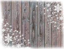 Fondo della cartolina di Natale con i fiocchi di neve e la struttura di legno Immagine Stock