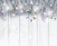 Fondo della cartolina di Natale con i rami e le pigne dell'abete Immagini Stock