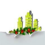 Fondo della città di Natale con agrifoglio fatto degli autoadesivi di carta Fotografia Stock