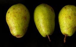 Fondo della frutta del raccolto delle pere Pere organiche fresche Pere saporite succose del raccolto di autunno della pera su fon Fotografie Stock Libere da Diritti