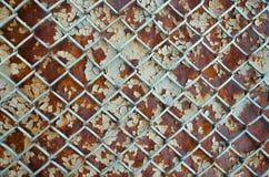Fondo della maglia metallica arrugginita Fotografia Stock