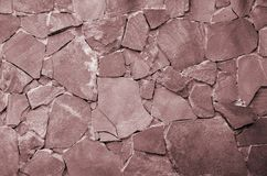 Fondo della parete di pietra - caratteristica della costruzione Struttura della parete spessa e forte delle pietre ruvide di vari fotografie stock