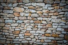Fondo della parete di pietra con i confini vignetted Fotografia Stock