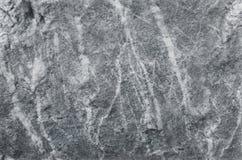 Fondo della parete di pietra, struttura grigia della roccia nel modello naturale con l'alta risoluzione per l'opera d'arte di pro Fotografia Stock