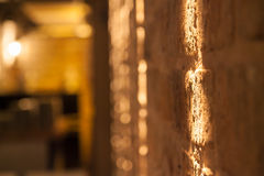 Fondo della parete messo a fuoco sulla luce fotografia stock