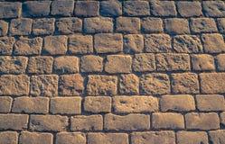 Fondo della pavimentazione del ciottolo con lo spazio della copia, textur del primo piano immagine stock libera da diritti