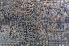 Fondo della pelle di coccodrillo macchiato viola Immagine Stock