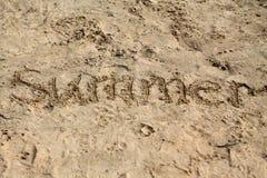 Fondo della sabbia con l'iscrizione fotografia stock