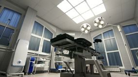 Fondo della sala operatoria moderna al carrello dell'ospedale Fotografia Stock