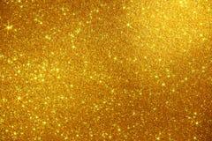 Fondo della scintilla delle stelle di scintillio dell'oro - foto di riserva