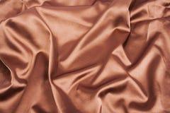 Fondo della seta piegata marrone del chocolote Fotografie Stock Libere da Diritti