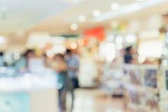 Fondo della sfuocatura del centro commerciale con bokeh Fotografia Stock Libera da Diritti