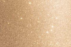 Fondo della stagnola di oro o luci vaghe scintilla di scintillio di struttura fotografie stock