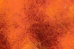 Fondo della superficie di metallo arrugginita ed arancio immagini stock libere da diritti