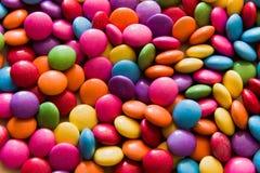 Fondo delle lenticchie del cioccolato Fotografie Stock Libere da Diritti