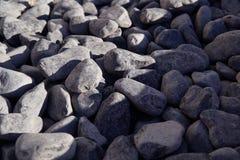 Fondo delle pietre grigio scuro fotografia stock
