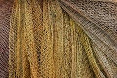 Fondo delle reti da pesca ed il colore giallo di tela da imballaggio Fotografia Stock Libera da Diritti