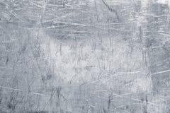 Fondo di alluminio del piatto, struttura graffiata del metallo come carta da parati Fotografie Stock