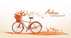 Fondo di autunno con le foglie variopinte e una bicicletta Fotografia Stock