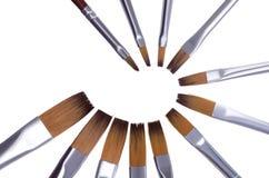 Fondo di bianco dei pennelli Fotografia Stock