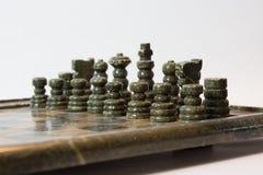 Fondo di bianco del singolo giocatore dell'insieme di scacchi Fotografia Stock Libera da Diritti