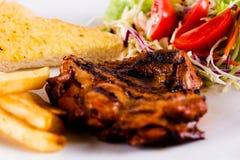 Fondo di bianco della bistecca Immagini Stock