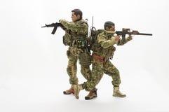 Fondo di bianco delle action figure del soldato dell'uomo del giocattolo Immagine Stock