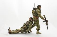 Fondo di bianco delle action figure del soldato dell'uomo del giocattolo Fotografie Stock