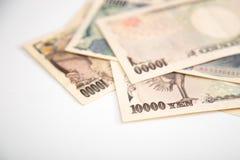 Fondo di bianco delle banconote di Yen giapponesi Fotografia Stock