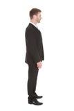 Fondo di bianco di Standing Isolated Over dell'uomo d'affari Immagini Stock