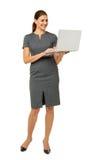 Fondo di bianco di Using Laptop Over della donna di affari Immagini Stock Libere da Diritti