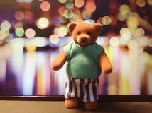 Fondo di Bokeh con un orso Fotografie Stock