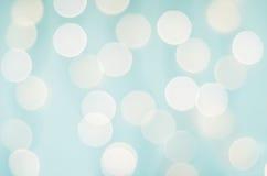 Fondo di Bokeh della luce bianca e di Pale Aqua Blue immagini stock libere da diritti