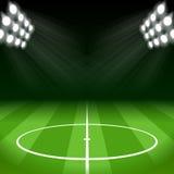 Fondo di calcio con le luci luminose del punto Fotografie Stock
