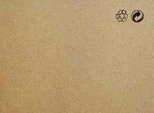Fondo di carta di struttura del cartone con il riciclaggio dei segni Fotografia Stock