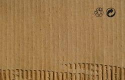 Fondo di carta di struttura del cartone con il riciclaggio dei segni Immagine Stock Libera da Diritti