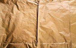 Fondo di carta dorato di struttura Fotografie Stock Libere da Diritti