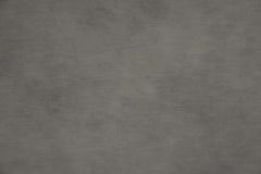 Fondo di carta grigio irregolare Immagini Stock