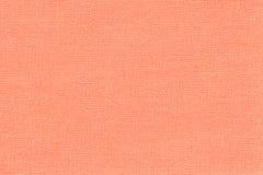 Fondo di corallo leggero da una materia tessile con il modello di vimini, primo piano fotografia stock