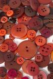 Fondo di cucito dei bottoni di Brown Fotografia Stock