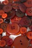 Fondo di cucito dei bottoni di Brown Fotografia Stock Libera da Diritti