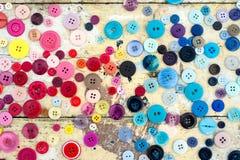Fondo di cucito Grungy dei bottoni fotografia stock