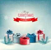 Fondo di festa di Natale con i presente. Immagine Stock