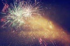Fondo di festa, luci di scintillio e sovrapposizione astratti del fuoco d'artificio Immagine Stock